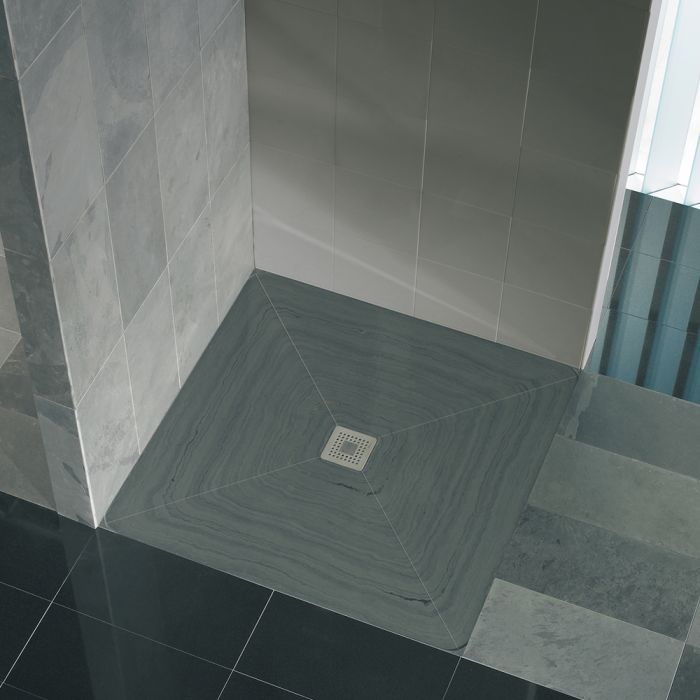 Shower and floor drains for one-piece natural stone shower trays